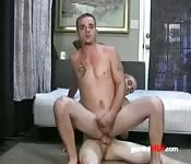 slender tattooed guy rides cock