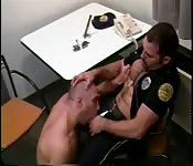 Uniformed hunk enjoying oral sex with a stranger