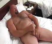 Chubby man playing with his big dick