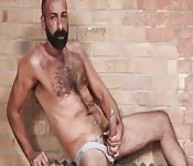Bearded mature guy playing with his huge cock
