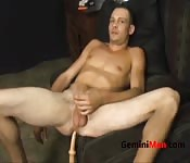 Muscle hunk pleasuring himself with a dildo
