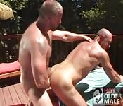 Two heafty guys fuck outdoor