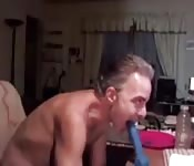 Dude sucks fake dick on webcam
