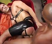 Latex-clad dude getting fucked by a black stud