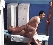 Hairy gent making love to a stranger in a locker room