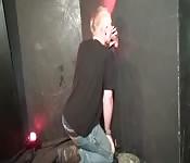 Blonde dude sucking a dick through a glory hole