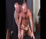Burly dude playing with his boyfriend cock
