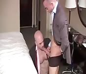 Underwear-clad dude face fucking a suited hunk