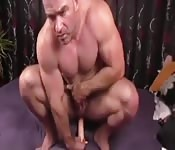 Hot muscle guy sitting on big dildo