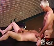 Grey-haired old stud being tongue fucked