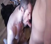Handsome bearded dude getting face fucked