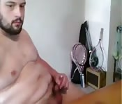 Bearded chub strokes his cock on cam