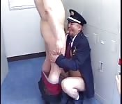 Uniformed Asian hunk blowing a chubby stranger