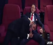Suited hunk getting blown in a movie theatre