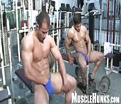 Muscular handjob at the gym