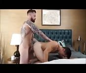 Hot tattooed studs riding dick in bed