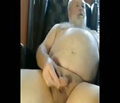 Fat mature man tugging his small cock