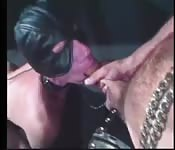 Blindfolded sex slave sucking a big prick