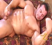 Oiled-up bodybuilder playing with his big dick