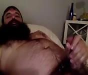 Hairy bearded hunk loves stroking his cock