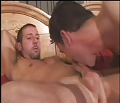 Big-dicked dude getting blown on his bed