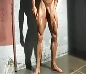 Huge bodybuilder working out solo