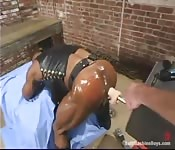Leather-clad sex slave getting dildo fucked