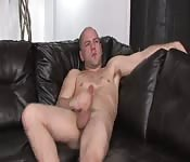 Salacious mature guy masturbating on his couch