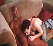 Young jeans-clad dude sucking a big black cock