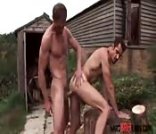 Dark haired man gets on his knees outdoors
