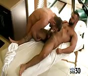 Alluring mature hunk getting blown by a kinky masseur