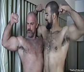 Two hairy muscle boys get each other doggy style