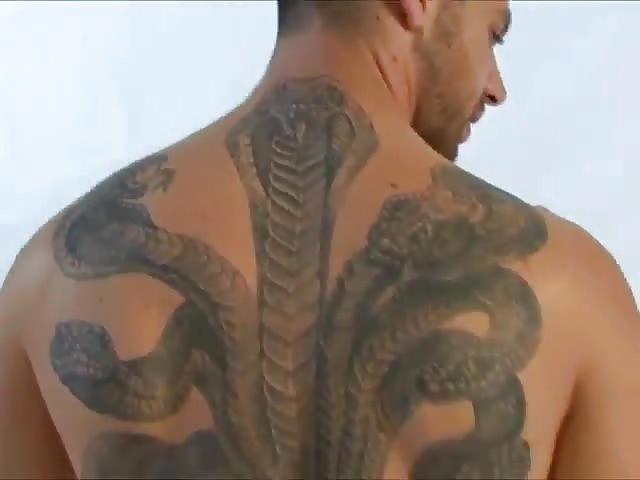 Tattooed hunk masturbating