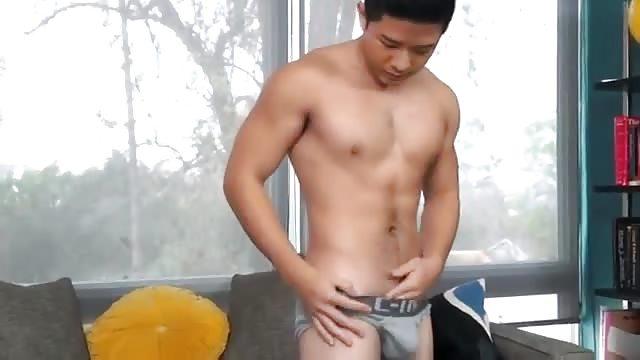 Asian guy masterbating