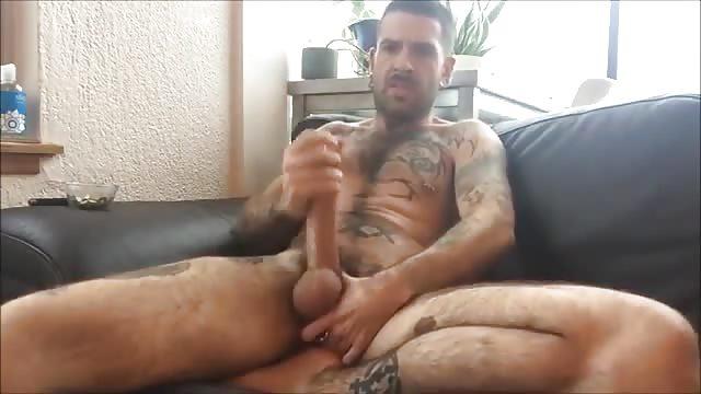 Tattooed gay jerking off