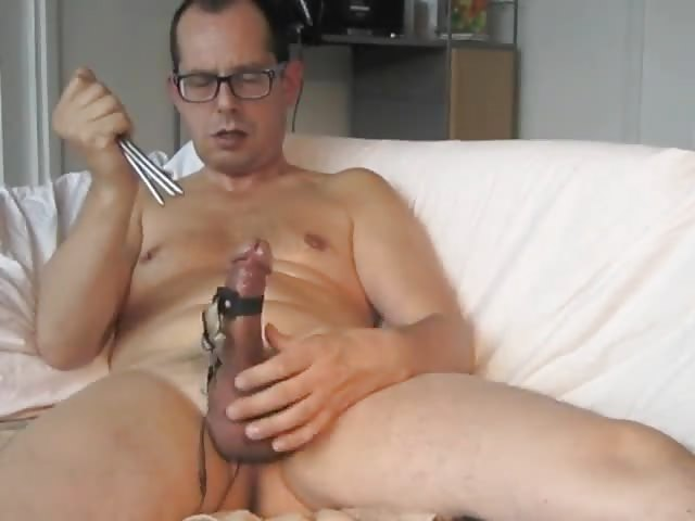 Slender hunk plays with his long cock