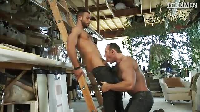 Horny dude sucks buddy in a garage