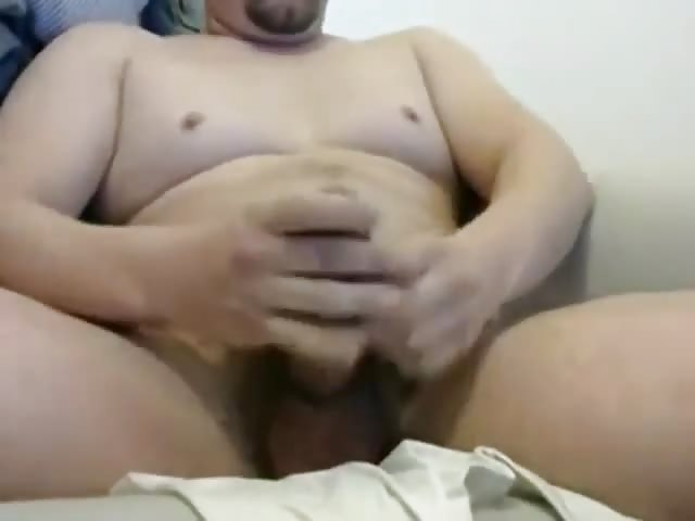 Hunk wanks his cock alone