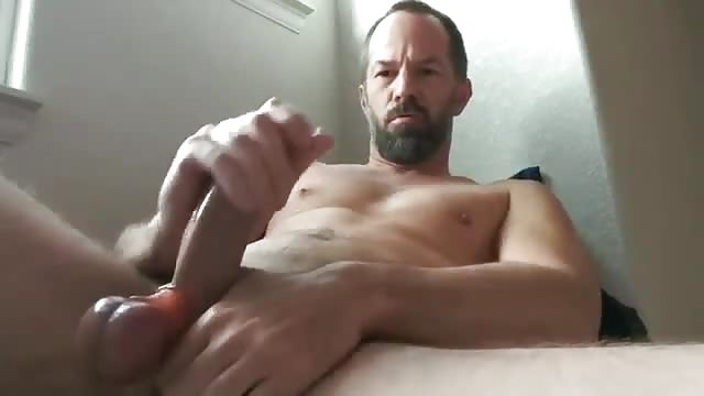 Muscular hunk solo plays with big dildo